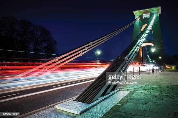 Long exposure of light trails crossing Clifton Suspension Bridge in Bristol England taken on November 28 2013