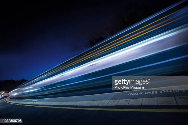 Long exposure of light trails from a passenger train at Bath Spa railway station, taken on February 1, 2018.