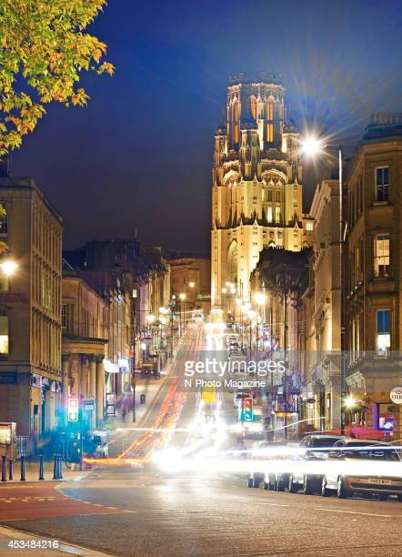 Long exposure of light trails on Park Street in Bristol England with the Wills Memorial Building visible in the background on November 7 2013