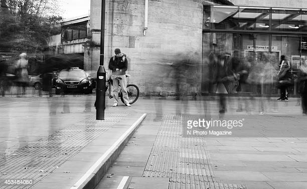 Long exposure of people emerging from Bath Spa train station, taken on November 28, 2013.