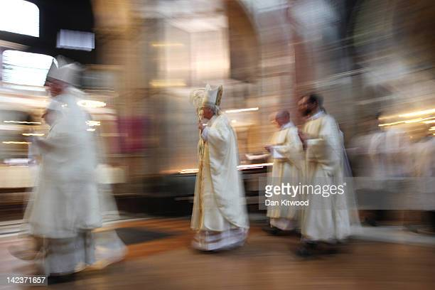 Long exposure of priests filing into Westminster Cathedral for the annual Chrism Mass on April 3 2012 in London England The Archbishop of Westminster...