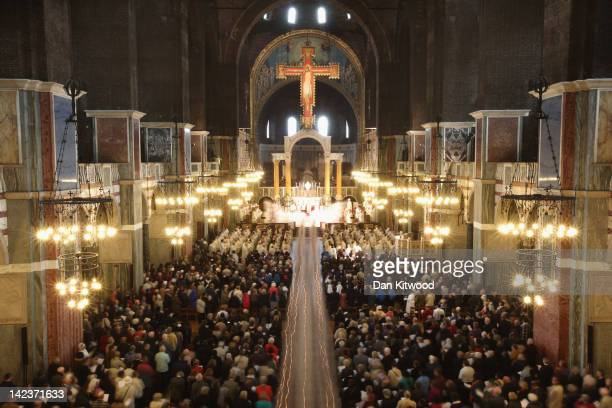 Long exposure of priests filing out of Westminster Cathedral after the annual Chrism Mass on April 3 2012 in London England The Archbishop of...
