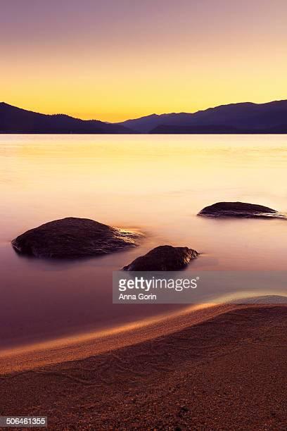 Long exposure of rocks at sunrise at Payette Lake