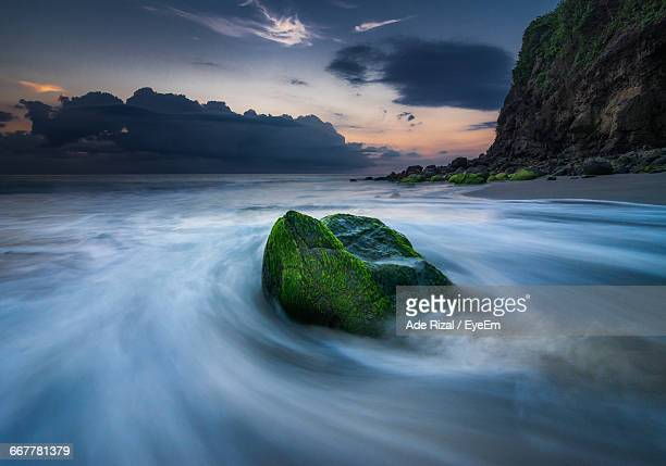 long exposure of sea against sky - ade rizal stock photos and pictures
