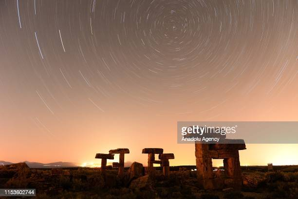 Long exposure of starlight trails in the night sky over the ruins at Blaundus ancient city at night in Ulubey district of Turkey`s Usak on July 03,...