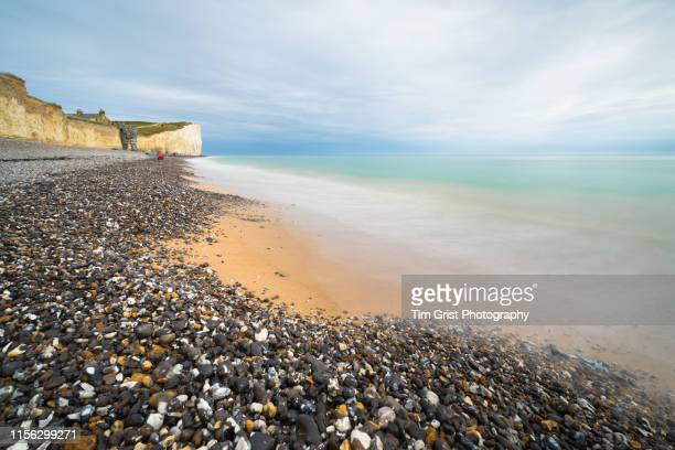 long exposure of the beach and chalk cliffs at birling gap, east sussex, uk - sussex stock pictures, royalty-free photos & images