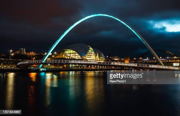 long exposure of the gateshead millennium bridge - newcastle upon tyne stock pictures, royalty-free photos & images