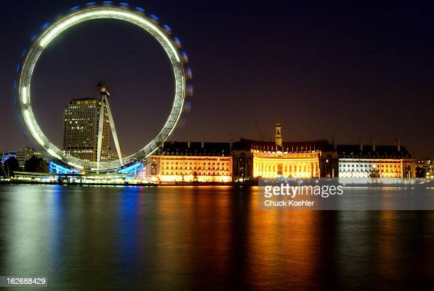 Long Exposure of the London Eye at Night. Very colorful image of the London Eye with reflections off of the Thames River.