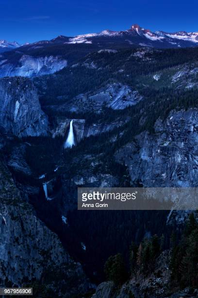 Long exposure of Vernal Fall and Nevada Fall at dusk viewed from iconic Glacier View overlook, summer in Yosemite National Park