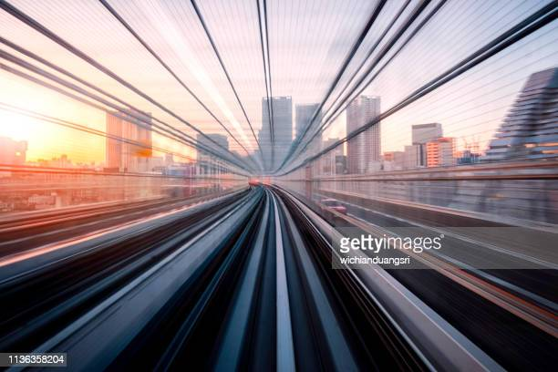 long exposure on tokyo train, japan - onderweg stockfoto's en -beelden