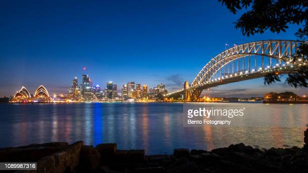 long exposure opera house with harbour bridge in sunset, sydney, australia - オペラ座 ストックフォトと画像