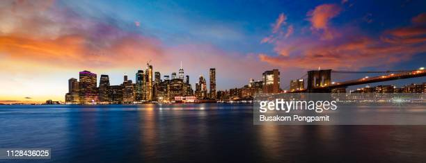 long exposure photo financial district and brooklyn bridge at night. new york - high dynamic range imaging stock pictures, royalty-free photos & images