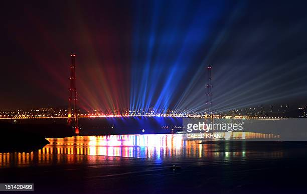 A long exposure photo lights up the 1872 meter bridge that connects Russky Island off Vladivostok and the Russian mainland on the eve of the Asia...