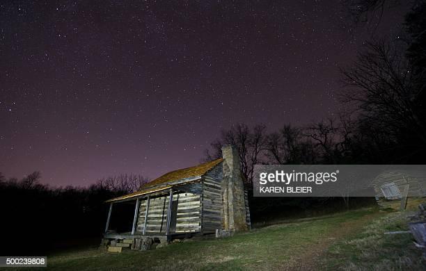 Long exposure photo of a replica log cabin at the Humpback Rocks Visitor Center, Blue Ridge Parkway, December 5 near Waynesboro, Virginia. AFP...
