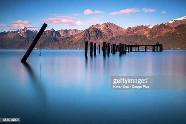 long exposure photo of old pier at north beach, south of seward, resurrection bay, southcentral alaska, autumn - golfo do alasca imagens e fotografias de stock