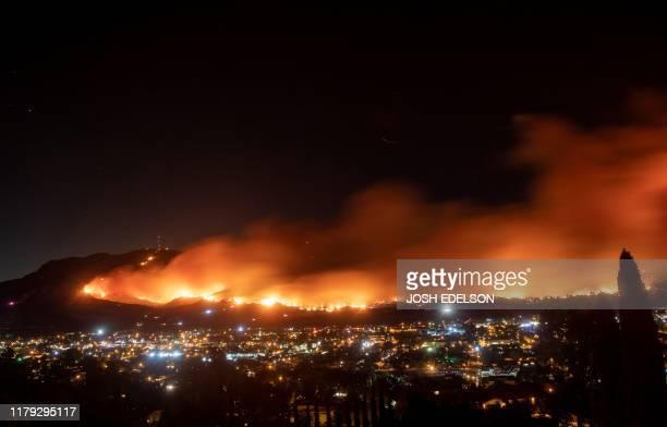 TOPSHOT A long exposure photo shows the Maria fire as it races across a hillside in Santa Paula California on November 1 2019