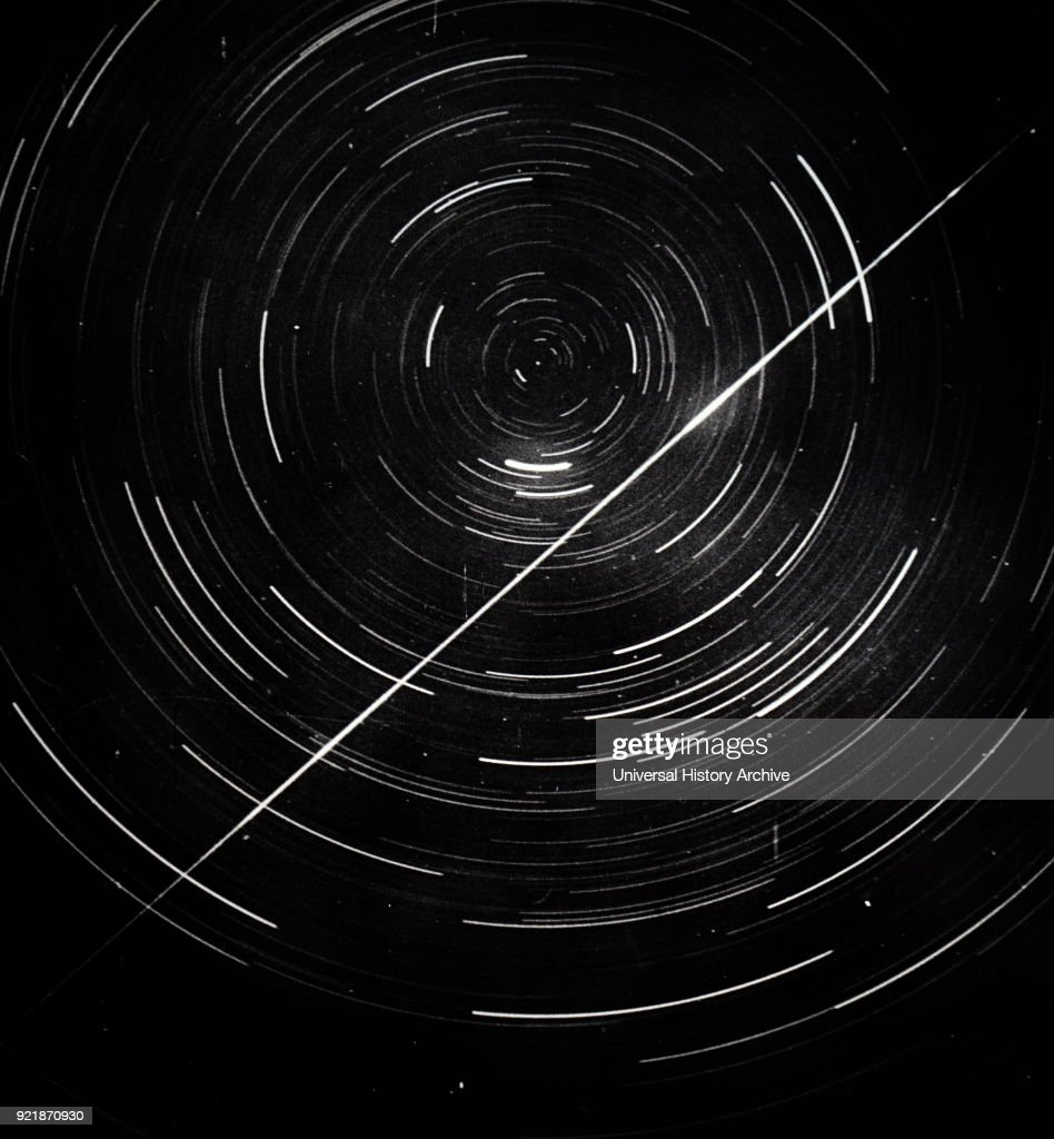 Long exposure photograph of a circumpolar stars, showing also a meteor trail. Dated 20th century.
