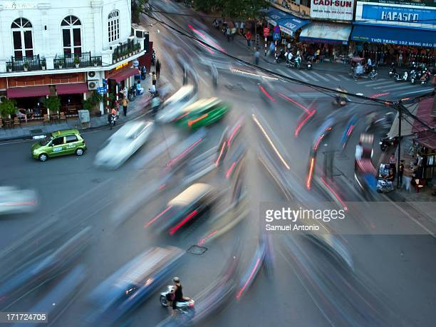 Long exposure photograph of traffic in the Old Quarter of Hanoi near Hoan Kiem Lake in Northern Vietnam. Taken from the City View Cafe on May 9,...