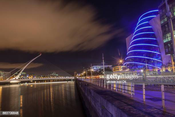 A long exposure picture of the Samuel Beckett Bridge over the river Liffey and The Convention Center Dublin in Dublin Ireland 19 August 2015