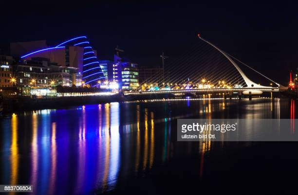 A long exposure picture Samuel Beckett Bridge over the river Liffey and The Convention Center Dublin in Dublin Ireland 19 August 2015