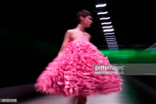 TOPSHOT A long exposure picture shows a model presenting a creation by Annakiki during the women's Fall/Winter 2018/2019 collection fashion show in...