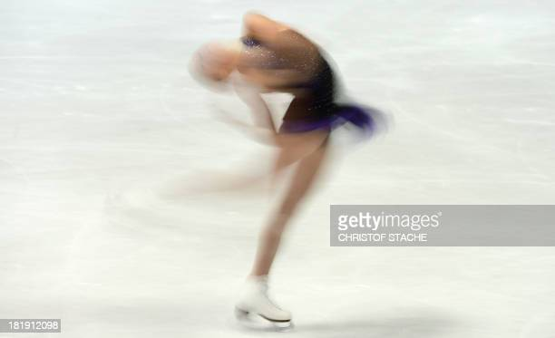 Long exposure picture shows US figure skater Ashley Cain performs during the ladies' short program of the 45th Nebelhorn trophy figure skating...