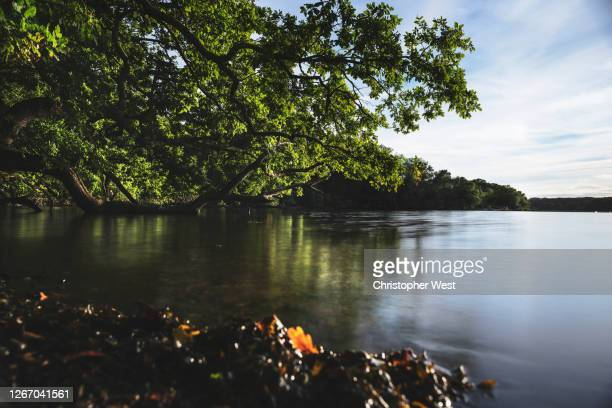 long exposure reflection on the river hamble - southampton england stock pictures, royalty-free photos & images