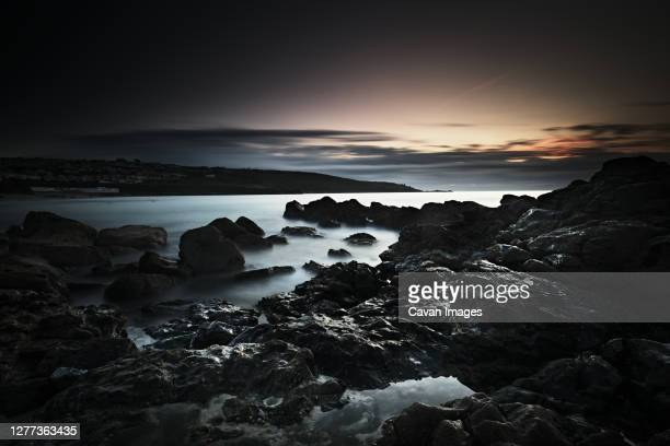 long exposure, rocks, setting sun - rock stock pictures, royalty-free photos & images