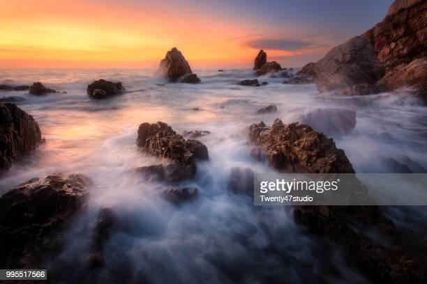 long exposure seascape photograph at sunset - provinz chonburi stock-fotos und bilder