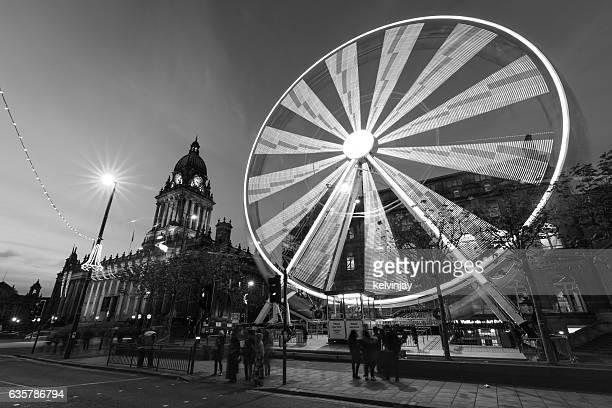 Long exposure shot of Leeds Town Hall and Ferris Wheel