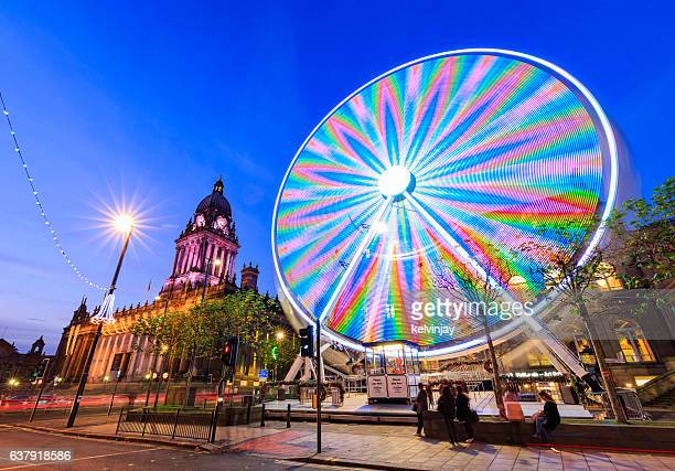 Long exposure shot of Leeds Town Hall and Ferris Wheel