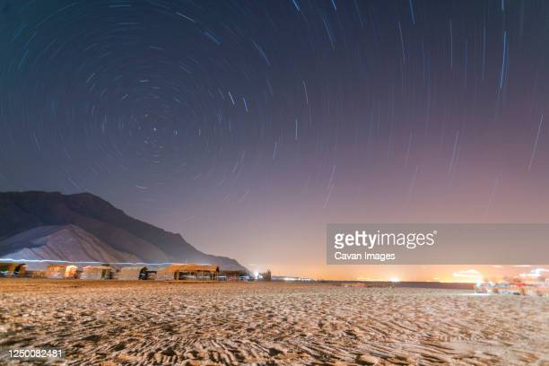 long exposure star trail in sinai with bungalows - tourism in south sinai stock pictures, royalty-free photos & images