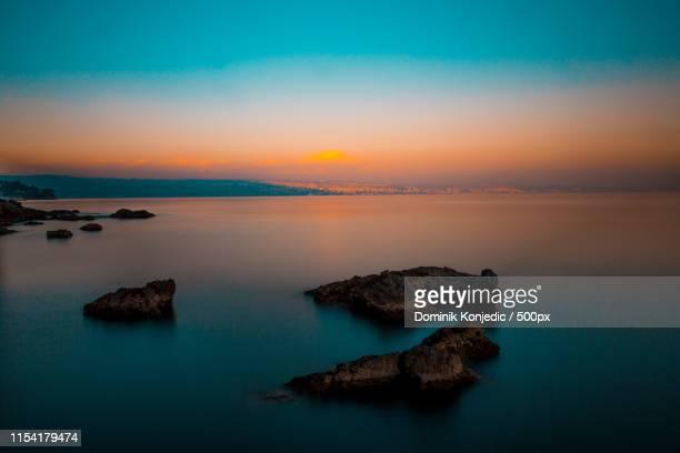 long exposure sunset shot - dominik konjedic stock pictures, royalty-free photos & images