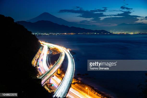 long exposure traffic light and mt. fuji at the morning in shizuoka, japan - shizuoka stock photos and pictures