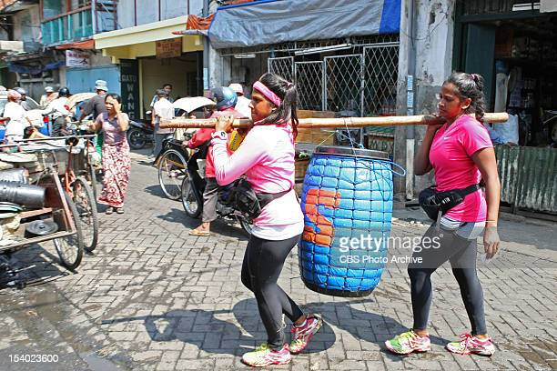 """""""Long Hair, Don't Care """" --In Detour B, Twins Nadiya and Natalie must carry and sort two barrels of fish in order to receive the next clue on THE..."""