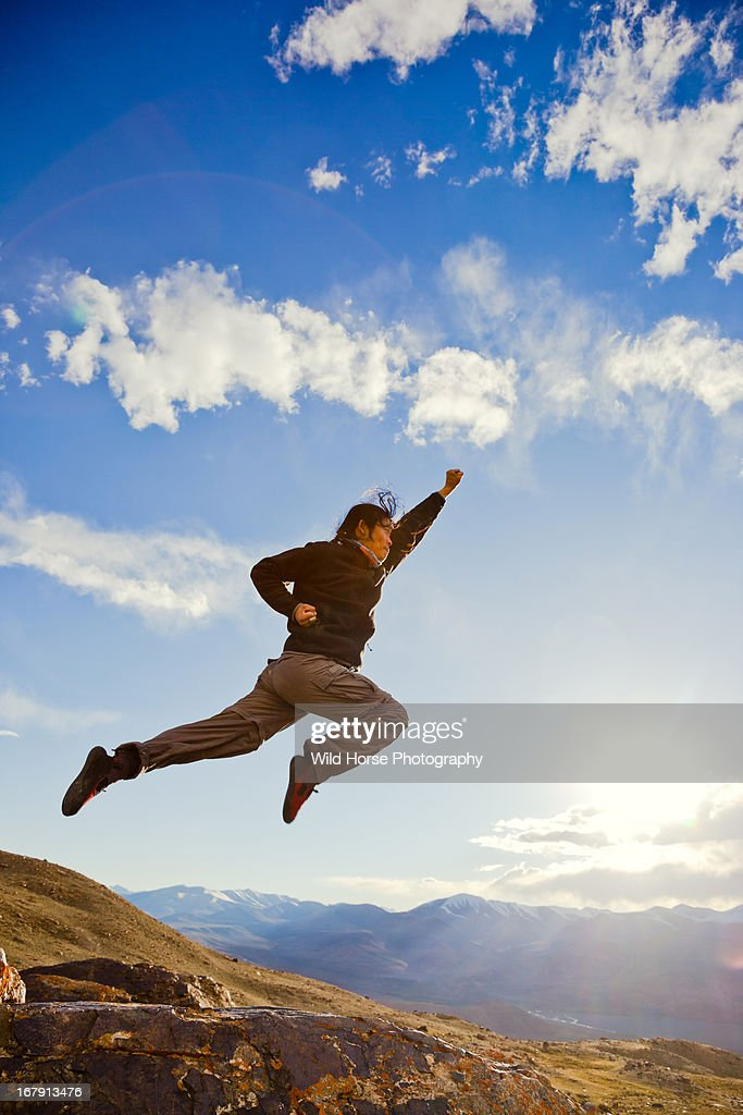 A long hair man flying like superman in the sky stock photo getty a long hair man flying like superman in the sky stock photo publicscrutiny Images