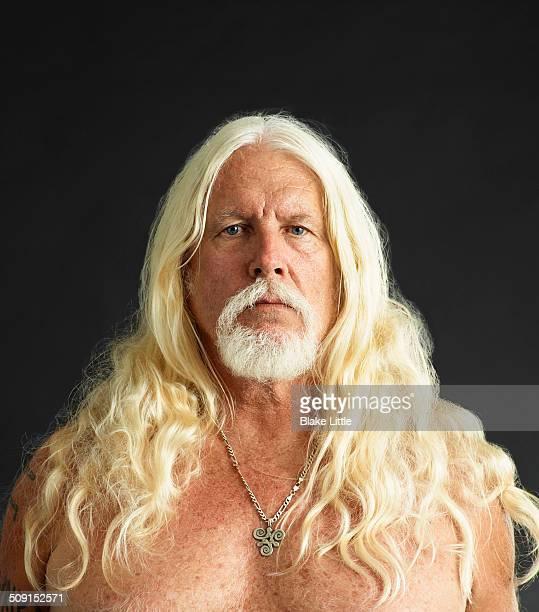 Long haired blond man studio.