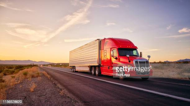 long haul semi truck on a rural western usa interstate highway - trucking stock pictures, royalty-free photos & images