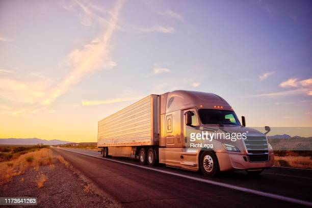 long haul semi truck on a rural western usa interstate highway - convoy stock pictures, royalty-free photos & images