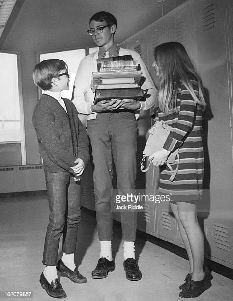 MAR 18 1968 MAR 30 1968 APR 3 1968 'Long' Helps 'Short' The tallest boy at Highland High School Jim Carpenter of 2560 Eppinger Blvd carries books for...