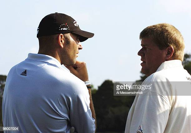 Long hitters Hank Kuehne and John Daly talk on the first tee during a practice round at Bay Hill Club, site of the PGA Tour Bay Hill Invitational,...