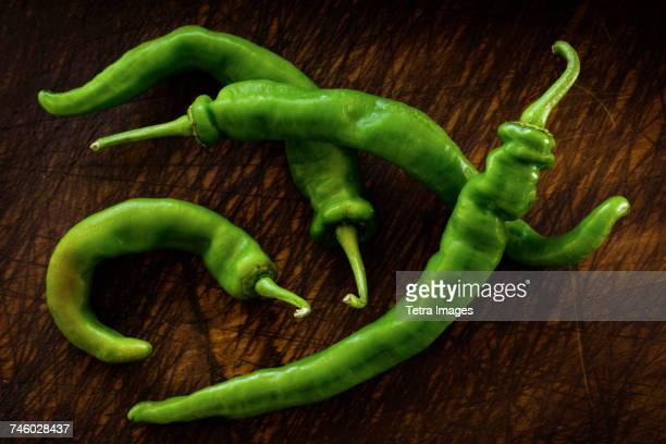 Long hot peppers on wooden table
