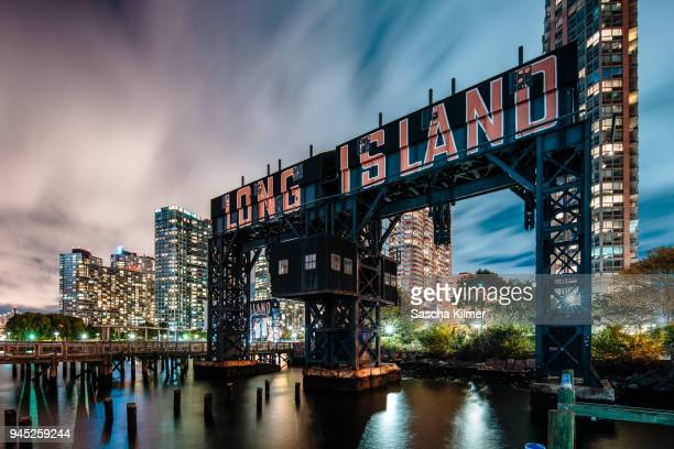 long island city gantry plaza park at night - queens new york city stock pictures, royalty-free photos & images