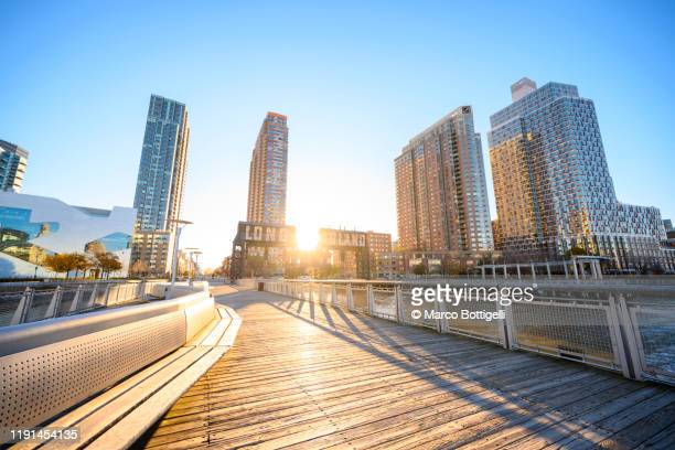 long island city piers at sunrise, new york city - queens new york city stock pictures, royalty-free photos & images