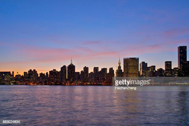 long island city skyline at dusk - long island stock pictures, royalty-free photos & images