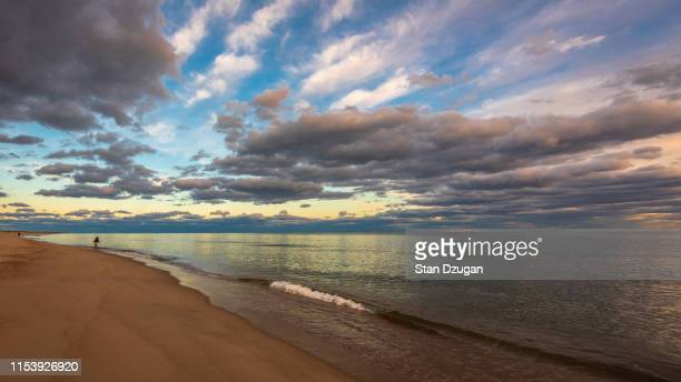 long island surf caster fishing. south shore of long island - east hampton stock pictures, royalty-free photos & images
