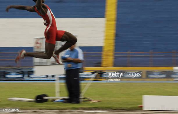 long jump action - length stock pictures, royalty-free photos & images