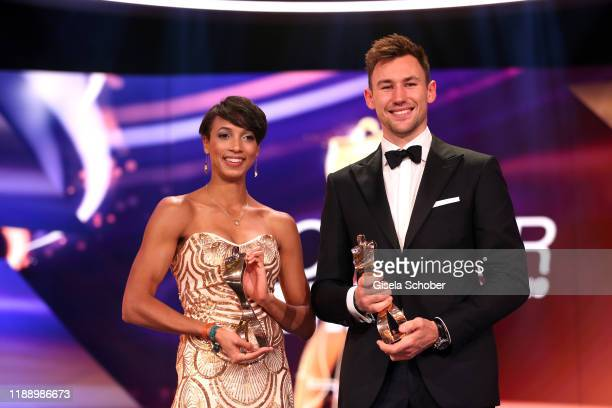 Long jump gold medalist Malaika Mihambo and Decathlete world champion Niklas Kaul with award during the 'Sportler des Jahres 2019' Gala at Kurhaus...