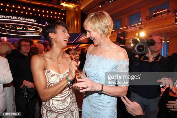 Long jump gold medalist Malaika Mihambo with award and former long jumper Heike Drechsler during the 'Sportler des Jahres 2019' Gala at Kurhaus...