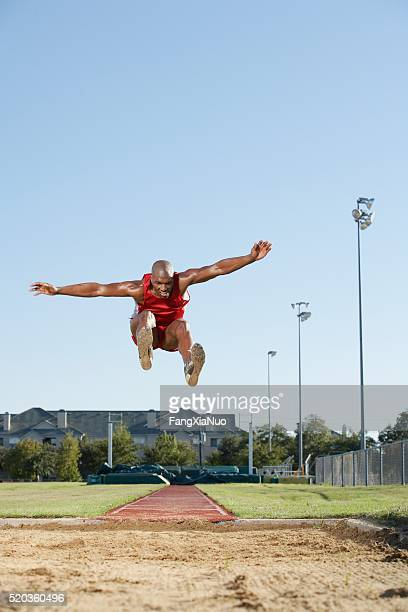 long jumper in air - forward athlete stock pictures, royalty-free photos & images